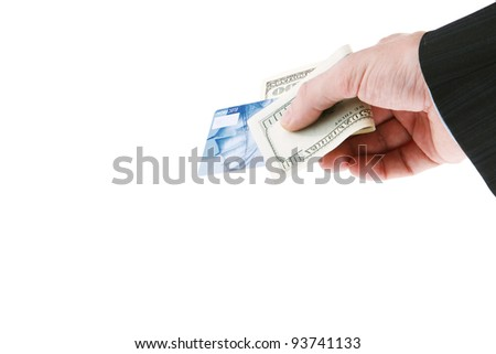 Businessman's hand holding one hundred dollars and blue credit cards. Isolated on white background