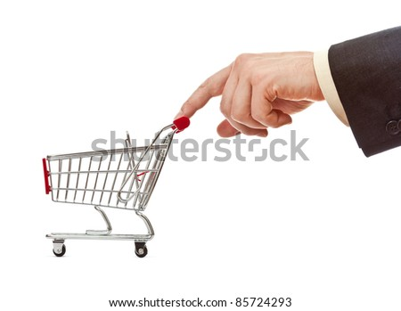 businessman's hand pushes shopping cart