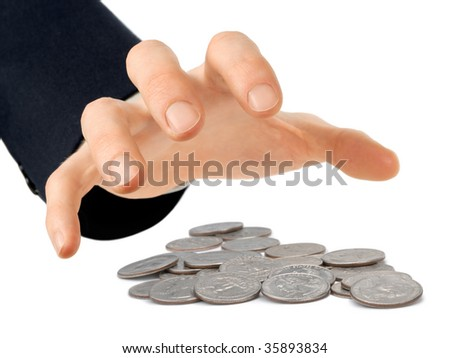 Businessman's hand reaching for a heap of quarters, isolated on white