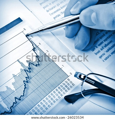 Businessman's hand showing diagram on financial report with pen. Business background 04