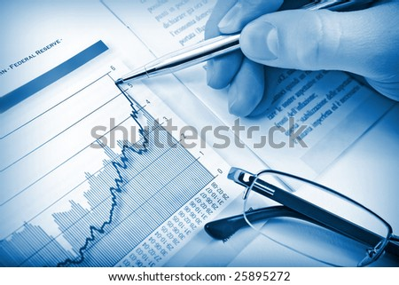 Businessman's hand showing diagram on financial report with pen. Business background 02 blue