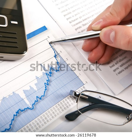 Businessman's hand showing diagram on financial report with pen. Business background 06 blue
