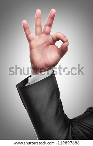 Businessman's hand showing OK sign  High resolution