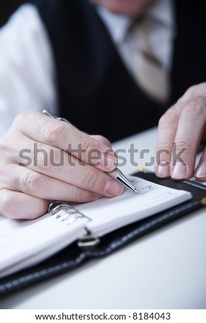 businessman's hand  with pan