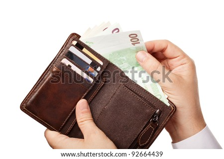Businessman's hands holding brown leather wallet full of money - various Euros (Eur) banknotes, isolated over white background - stock photo