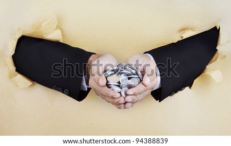Businessman's hands holding coins