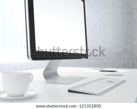 Businessman's place of work with with computer monitor cup of coffee keyboard and smartphone on white table
