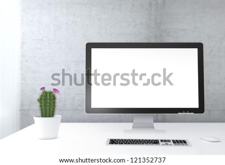 Businessman's place of work with with computer monitor, keyboard and cactus on white table next to concrete wall