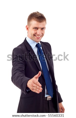 Businessman saying welcome and being ready to shake hands - stock photo