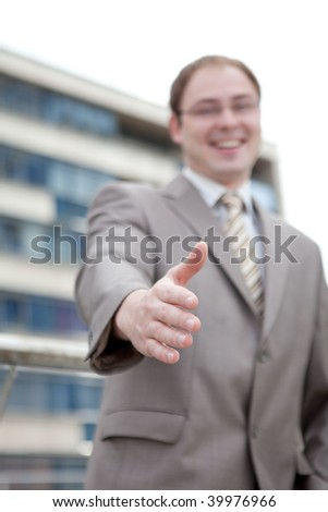 Businessman saying welcome - handshake (outdoor the office)