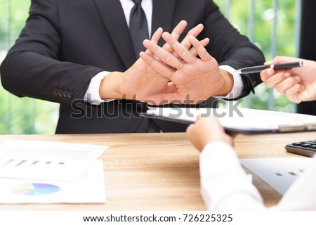 Businessman says no or hold on when businesswoman giving pen for signing a contract. #726225325