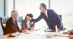 Businessman scolding his colleague in conference room