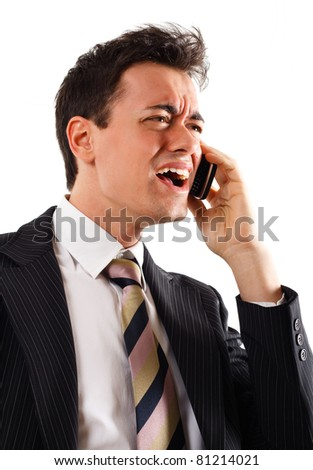 Businessman screaming at the phone. Isolated on white.