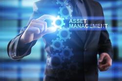 Businessman selecting Asset management.