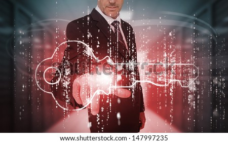 Businessman selecting futuristic key graphic in data center