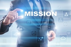 Businessman selecting mission on virtual screen.