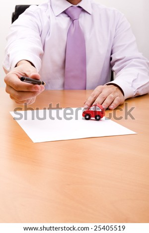 businessman selling a new car at his office (selective focus)