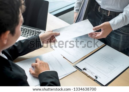 Businessman sending a resignation letter to employer boss in order to resign dismiss contract, changing and resigning from work concept. Сток-фото ©