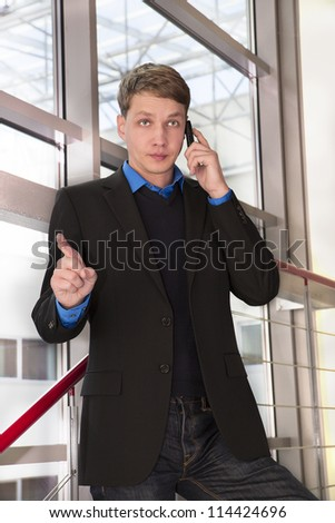 Businessman seriously talking with his employees by telephone