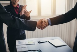 Businessman shaking hands agreement confirmed in the investment business.