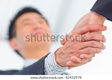 businessman shaking hands over a deal