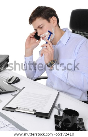 Businessman shaves in the workplace