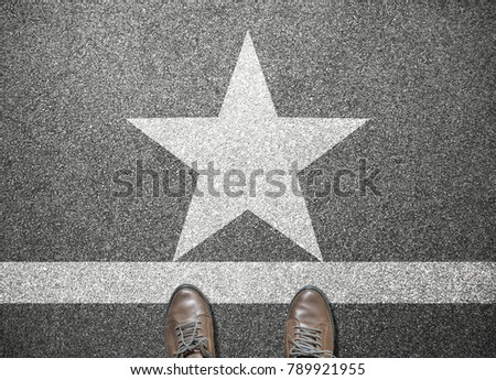 businessman shoes stand on road with star sign
