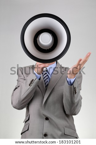 Businessman shouting into a megaphone concept for communication, news, announcement and business motivation