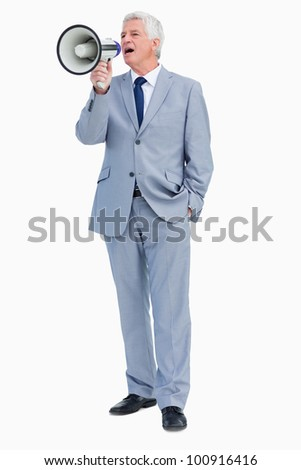 Businessman shouting with megaphone against white background