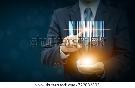 Photo of  businessman show barcode with glow light on hand, warehouse and logistics