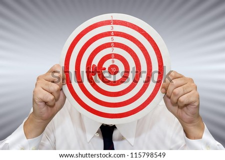 Businessman show the dart and target accuracy