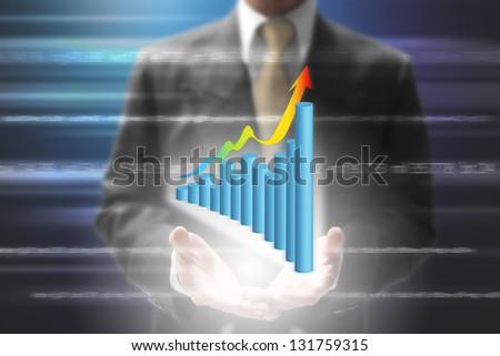 businessman show virtual graph on hand.