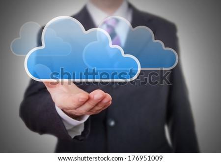 Businessman showing a Cloud - Shutterstock ID 176951009
