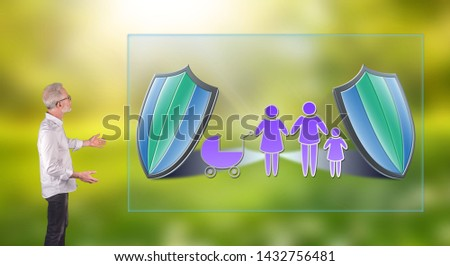 Businessman showing a family insurance concept on a wall screen
