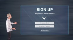 Businessman showing a signup concept on a wall screen