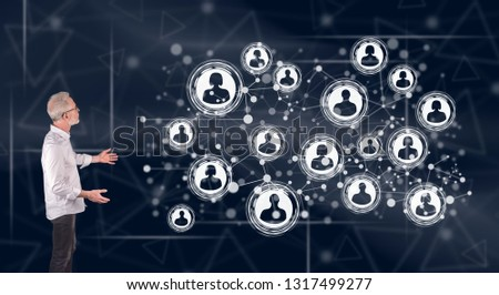 Businessman showing a social network concept on a wall screen #1317499277