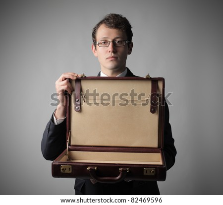 Businessman showing an empty briefcase