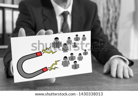 Businessman showing an index card with customer attraction concept #1430338013