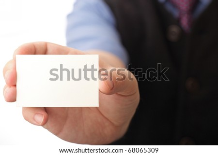 Businessman showing business card - focus on fingers and card. You can just add your text there.