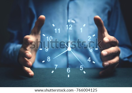 Businessman showing clock. Concept of saving time. #766004125