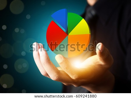 Businessman showing colorful pie graph