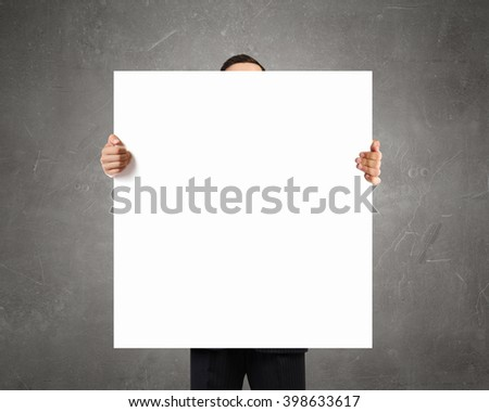 Businessman showing empty banner #398633617