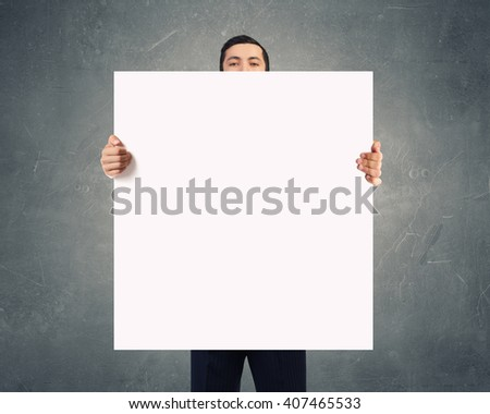 Businessman showing empty banner #407465533