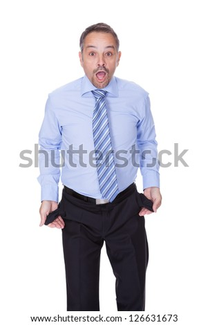 Businessman Showing Empty Pockets On White Backgrounds