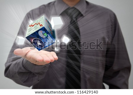 Businessman showing finance cubes in his open palm