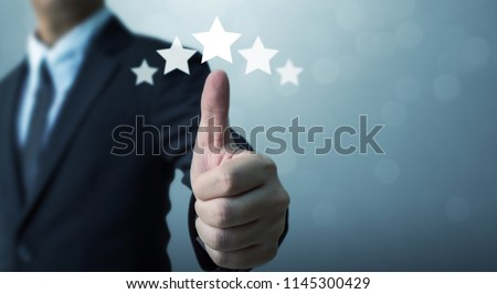 Businessman showing hand sign thumb up and five star symbol to increase rating of company, The excellence of the business or service concept #1145300429