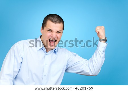 Businessman showing his biceps, on blue background