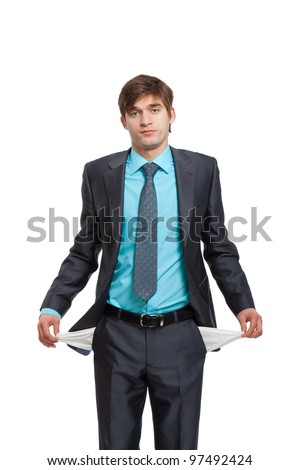 businessman showing his empty pocket, turning his pocket inside out, concept no money, Handsome young business man standing isolated on the white background - stock photo