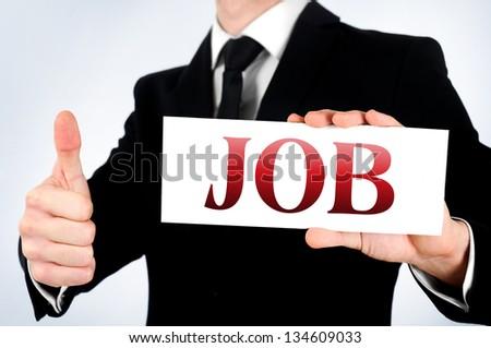 Businessman showing job word on card