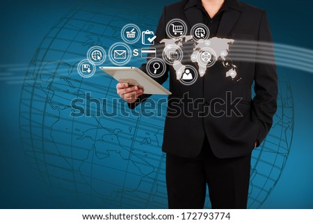 Businessman showing map and icon application on virtual screen. Concept of online business.
